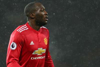 Lukaku carried off after clash of heads
